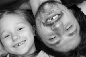 Father and daughter with missing teeth need their emergency dentist