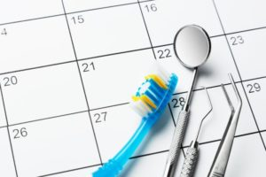 dental tools sitting on top of a calendar