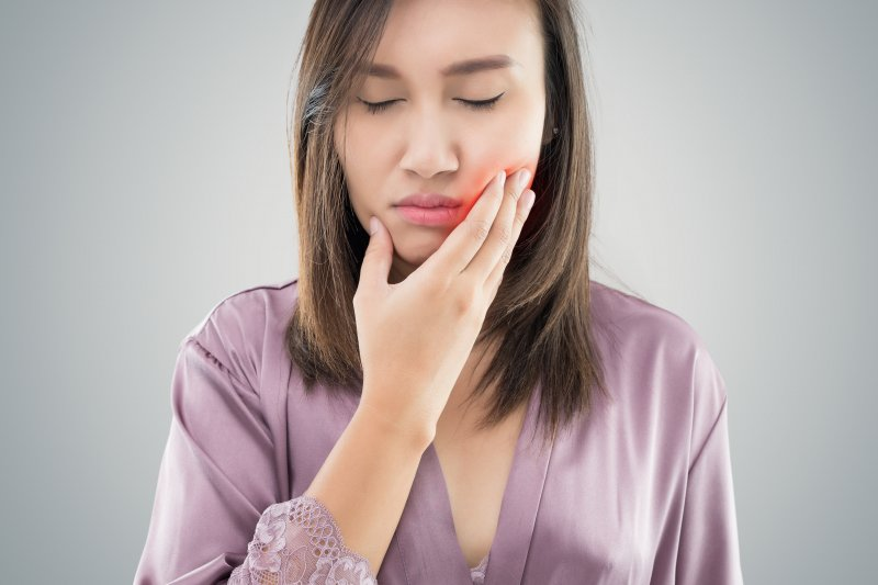 woman frowning from jaw pain