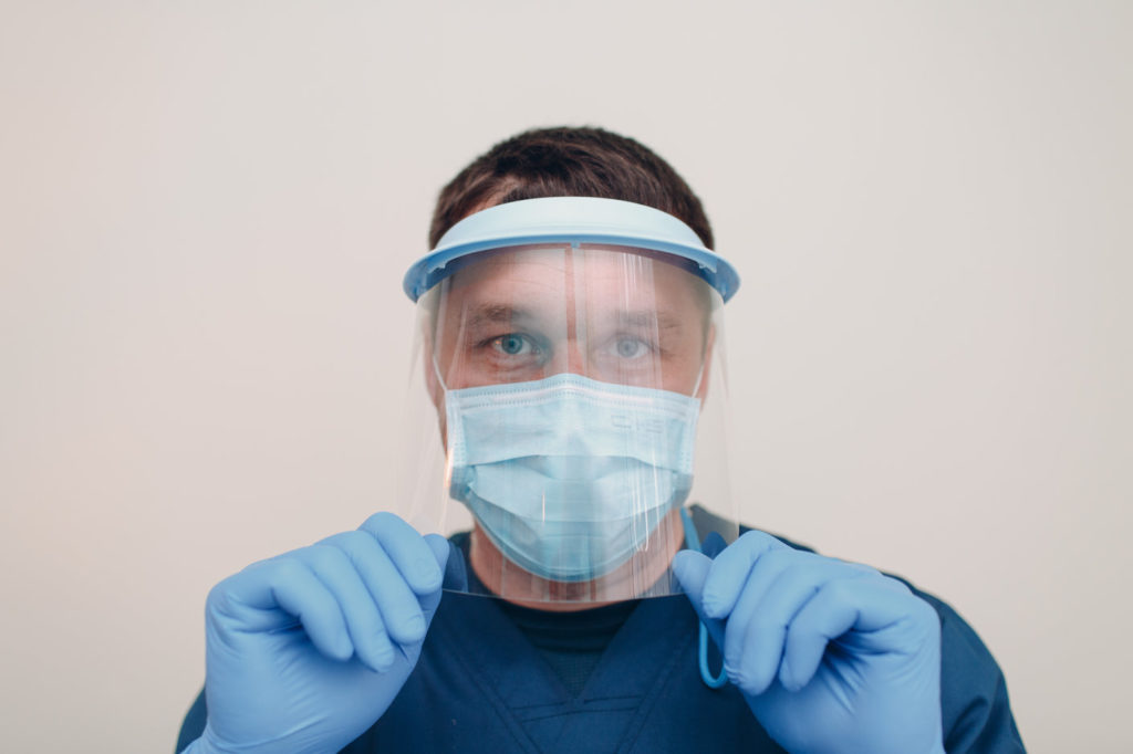 A dentist in Reno uses protective equipment.