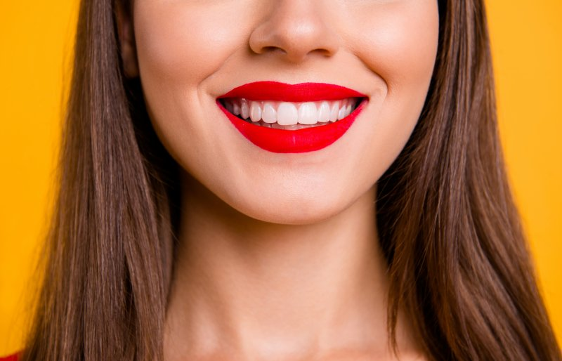 Woman smiling after gum recontouring procedure