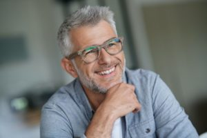gray-haired man smiling after seeing his cosmetic dentist in Reno